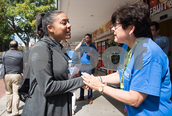 09/13/17 Wesley Bunnell | Staff CCSU students and faculty including President Dr. Zulma Toro toured downtown New Britain Wednesday afternoon on a listening tour with local business on their views of CCSU's interactions with the city. Dr. Laurice Guillory, L , speaks with CCSU Dr. Zulma Toro outside of C-Town Supermarket.