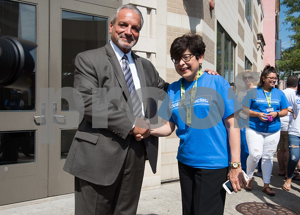09/13/17 Wesley Bunnell | Staff CCSU students and faculty including President Dr. Zulma Toro toured downtown New Britain Wednesday afternoon on a listening tour with local business on their views of CCSU's interactions with the city. New Britain Board of Education's Chief Operating Officer Paul Salina poses for a photo with CCSU President Dr. Zulma Toro outside of the Board of Education building.