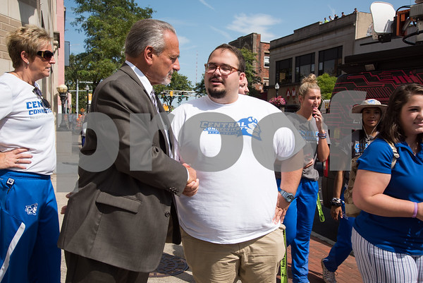 09/13/17 Wesley Bunnell | Staff CCSU students and faculty including President Dr. Zulma Toro toured downtown New Britain Wednesday afternoon on a listening tour with local business on their views of CCSU's interactions with the city. New Britain Board of Education's Chief Operating Officer Paul Salina stops to speak with Ray Rabuska an education major at CCSU.