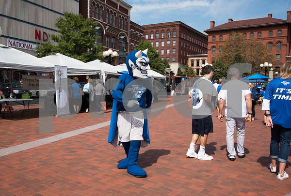 09/13/17 Wesley Bunnell | Staff CCSU students and faculty including President Dr. Zulma Toro toured downtown New Britain Wednesday afternoon on a listening tour with local business on their views of CCSU's interactions with the city. The Blue Devil mascot walks through Central Park.