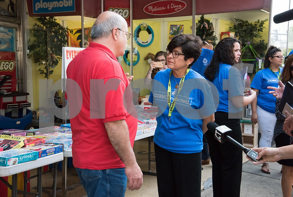 09/13/17 Wesley Bunnell | Staff CCSU students and faculty including President Dr. Zulma Toro toured downtown New Britain Wednesday afternoon on a listening tour with local business on their views of CCSU's interactions with the city. Steve Amato , owner of Amato's Toys speaks with CCSU President Dr. Zulma Toro.