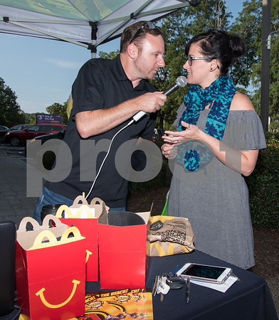09/13/17 Wesley Bunnell | Staff Mayor Erin Stewart along with Radio 104.1 hosts David Fisch and Amy Grey collected monetary donations for Hurricane Irma Relief at McDonalds on West Main Street Wednesday afternoon. All donations benefited both people and pets through the GlobalGiving.org charity. Lisa Falkner of Compass Wellness Center donated on behalf of the center and is interviewed by David Fisch. The Happy Meal containers were used to collect donations.