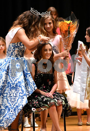 9/15/2017 Mike Orazzi | Staff Miss Mum 2017 Emma Guilmette is crowned Friday night at the Chippens Hill Middle School.