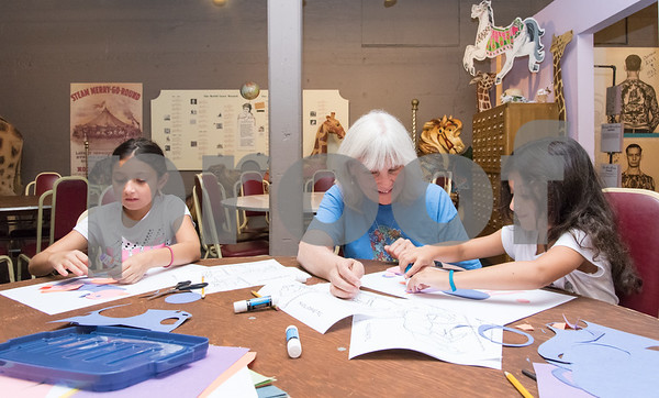 09/18/17 Wesley Bunnell | Staff The Bristol Carousel Museum is holding Fun with Carousel Animal Drawing on Monday nights through October 16th. Sisters Gianna Botto, age 9 L, and Olivia Botto, age 5, work with volunteer art teacher Cate Mahoney who teaches art at Kaynor Technical High School in Waterbury.