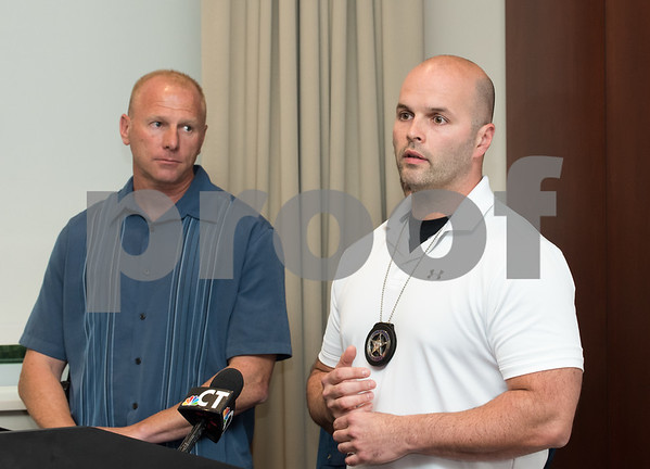 09/18/17 Wesley Bunnell   Staff A briefing was held Monday afternoon at the New Britain Police Department regarding the apprehension of Jermaine Scott. Scott has been a fugitive since March in a triple shooting of a woman and two children. New Britain Police Captain Thomas Steck, L, and U.S. Marshall task force supervisor Brian O'Neill.