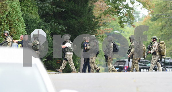 09/21/17 Wesley Bunnell | Staff SWAT members walk down Gilbert Rd on Thursday afternoon at the end of a police standoff.