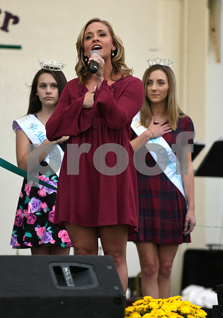 9/21/2017 Mike Orazzi | Staff Mum Festival Grand Marshal Brittany Decker sings the Star Spangled Banner during the 56th Annual Chrysanthemum Festival on opening night in Bristol Thursday.