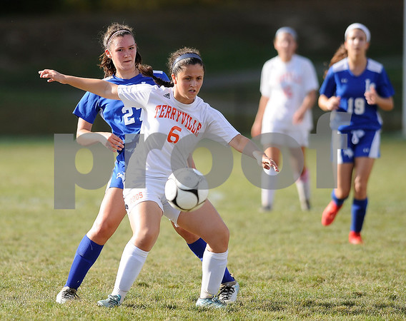 9/27/2017 Mike Orazzi | Staff Terryville's Kelly Poulin (6) and Litchfield's Allie Davenport (27) during Wednesday's soccer match at Terryville High School.