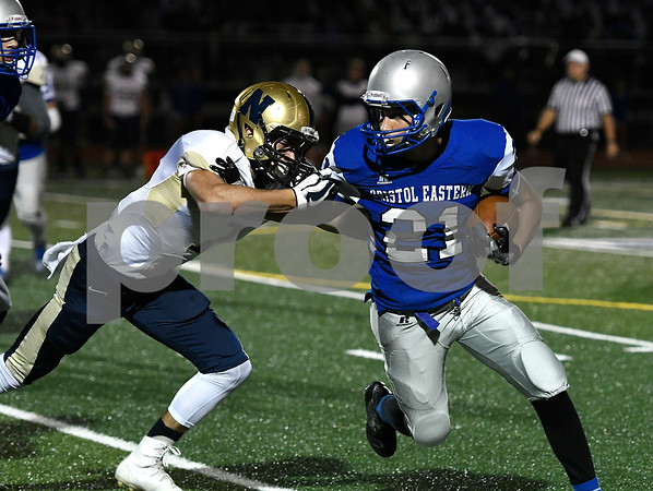 9/28/2017 Mike Orazzi | Staff Newington's Luke Pappalardo (1) and Bristol Eastern's Ariza Kolloverja (21) during Thursday night's football game in Bristol.