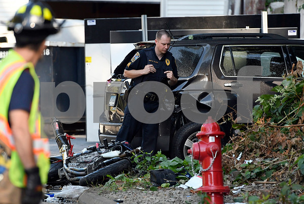 9/29/2017 Mike Orazzi | Staff Rescue personnel on scene of a motorcycle crash in the area of 100 Broad Street in the Forestville section of Bristol Friday afternoon.