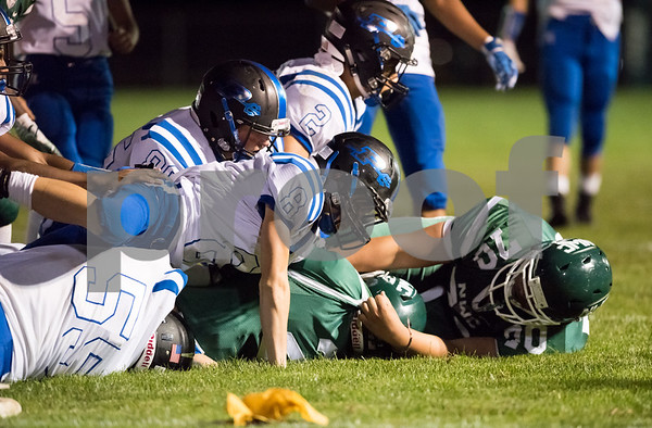 09/29/17 Wesley Bunnell | Staff Plainville football vs Northwest Catholic in West Hartford on Friday night. A plethora of Plainville players tackle the Northwest Catholic runner.