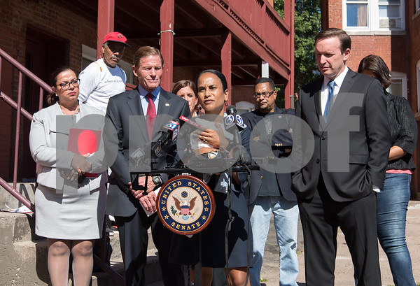 09/29/17 Wesley Bunnell | Staff Sen. Richard Blumenthal and Sen. Chris Murphy met with leaders of the Puerto Rican community at Aqui Me Quedo Restaurant in Hartford to discuss ways to help the island after Hurricane Maria. Hartford Common Council member Wildaliz Bermudez speaks at the podium in front of other community leaders and Sen. Blumenthal, L, and Sen. Murphy.