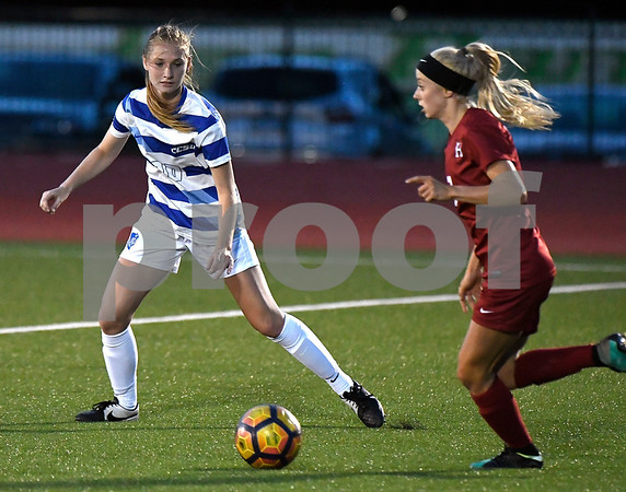 9/1/2017 Mike Orazzi   Staff CCSU's Danielle Pearse (10) and Harvard's Meg Tveit (7) during the CCSU Soccer Tournament in New Britain Friday night.