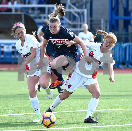 9/1/2017 Mike Orazzi   Staff UConn's Kess Elmore (7) and St. John's Mikhaila Martinov (7) and Christine McBeath (2) during the CCSU Soccer Tournament in New Britain Friday evening.