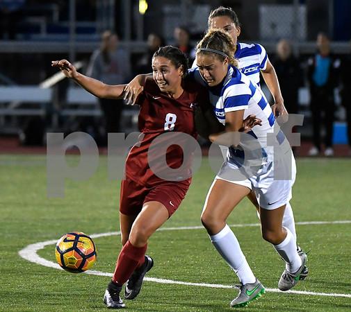 9/1/2017 Mike Orazzi   Staff CCSU's Nicole Russell (15) and Harvard's Lauren Raimondo (8) during the CCSU Soccer Tournament in New Britain Friday night.