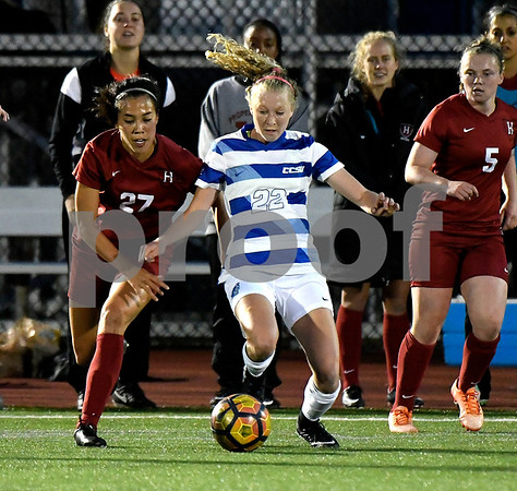 9/1/2017 Mike Orazzi | Staff CCSU's Jenna Rae Covello (22) and Harvard's Candy Janachowski (27) during the CCSU Soccer Tournament in New Britain Friday night.