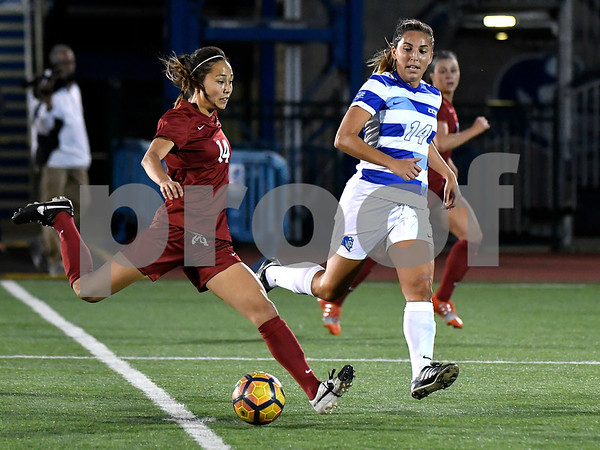 9/1/2017 Mike Orazzi | Staff CCSU's Charlotte Maurer (14) and Harvard's Dani Stollar (14) during the CCSU Soccer Tournament in New Britain Friday night.