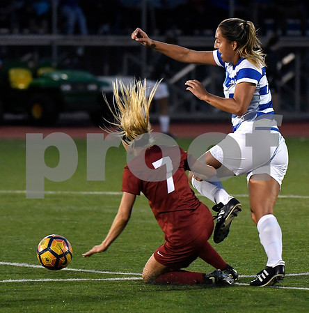 9/1/2017 Mike Orazzi   Staff CCSU's Charlotte Maurer (14) and Harvard's Meg Tveit (7) during the CCSU Soccer Tournament in New Britain Friday night.