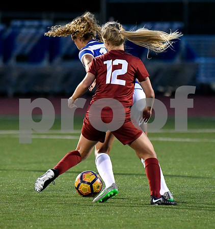 9/1/2017 Mike Orazzi   Staff CCSU's Nicole Russell (15) and Harvard's Murphy Agnew (12) during the CCSU Soccer Tournament in New Britain Friday night.
