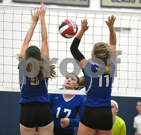 9/13/2017 Mike Orazzi | Staff Bristol Eastern's Gabriella Nozzolillo (17) and Southington's Sarah Myrick (9) and Hannah Zelina (11) Wednesday night.