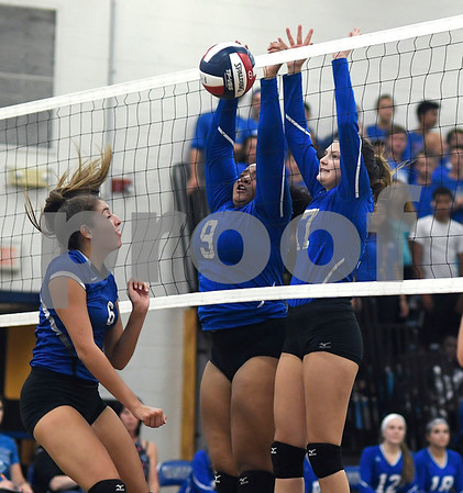 9/13/2017 Mike Orazzi | Staff Southington's Erica Bruno (6) and Bristol Eastern's Sienna White (9) and Gabriella Nozzolillo (17) Wednesday night.