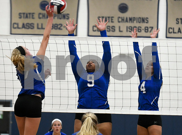 9/13/2017 Mike Orazzi | Staff Southington's Haley Larrabee (7) and Bristol Eastern's Sienna White (9) and Olivia Beaudoin (4) Wednesday night.