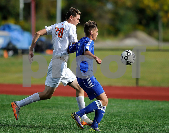 9/14/2017 Mike Orazzi | Staff Terryville's Kyle Miranda (20) and Lewis Mills' Nick Lutrzykowski (7) during boys soccer in Plymouth Thursday.