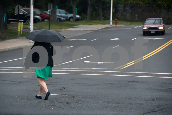 9/14/2017 Mike Orazzi | Staff A pedestrian walks through the intersection of Main Street and Riverside Avenue in Bristol during a rain shower Thursday.