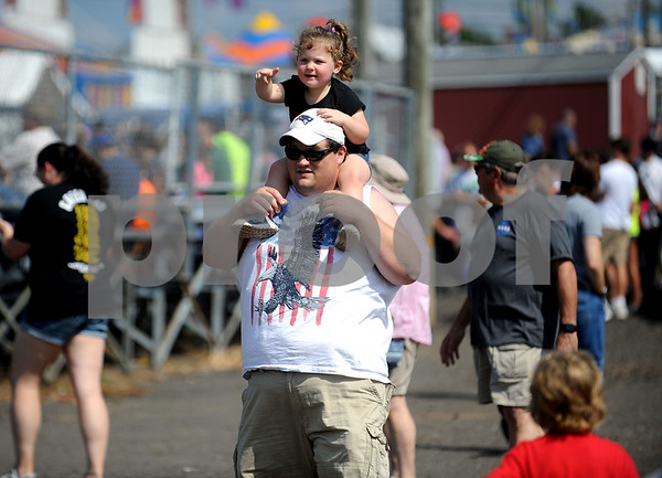 9/16/2017 Mike Orazzi | Staff Marley Guay,2, points to attractions while on her father Chris' shoulders during the Berlin Lions Club Fair Saturday.
