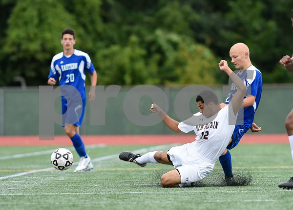 09/19/17 Wesley Bunnell | Staff Bristol Eastern boys soccer defeated New Britain 7-0 on Tuesday afternoon at Veteran's Stadium in New Britain. New Britain's Kevin Carrasavillo (12) fights with Bristol Easterns Lyle Winiarski #27 for the ball.
