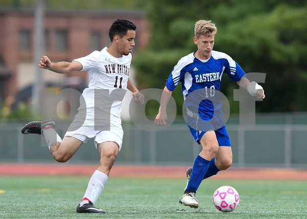 09/19/17 Wesley Bunnell | Staff Bristol Eastern boys soccer defeated New Britain 7-0 on Tuesday afternoon at Veteran's Stadium in New Britain. New Britain's Joao Perdo Coelho (11) and Bristol Easterns Jake Woznicki #10.