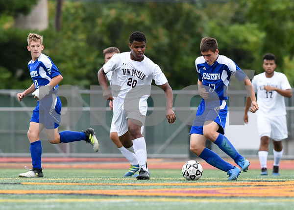 09/19/17 Wesley Bunnell | Staff Bristol Eastern boys soccer defeated New Britain 7-0 on Tuesday afternoon at Veteran's Stadium in New Britain. New Britain's Carlos Mendez (20) and Bristol Easterns Ben Chiasson #17.