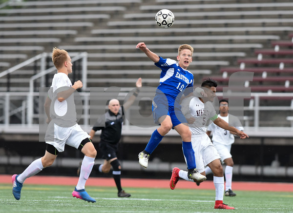 09/19/17 Wesley Bunnell | Staff Bristol Eastern boys soccer defeated New Britain 7-0 on Tuesday afternoon at Veteran's Stadium in New Britain. Bristol Easterns Jake Woznicki #10 goes up for a header.