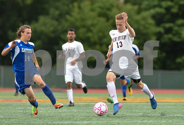 09/19/17 Wesley Bunnell | Staff Bristol Eastern boys soccer defeated New Britain 7-0 on Tuesday afternoon at Veteran's Stadium in New Britain. Bristol Easterns Justin Jacques #14 and New Britain's Nick Makuch (13).