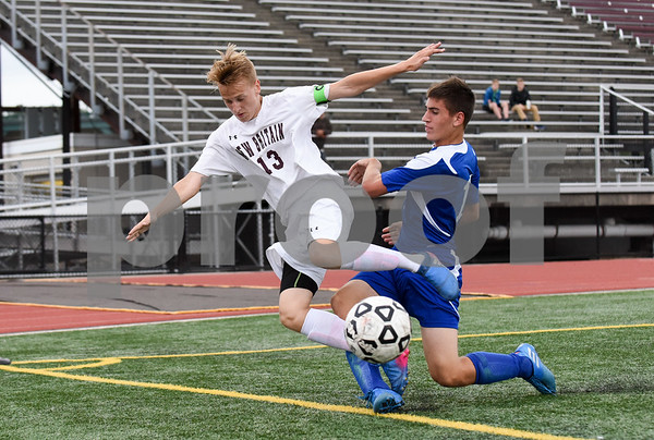 09/19/17 Wesley Bunnell | Staff Bristol Eastern boys soccer defeated New Britain 7-0 on Tuesday afternoon at Veteran's Stadium in New Britain. New Britain's Nick Makuch (13) gets tripped up by the Bristol Eastern player.