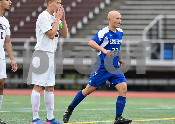 09/19/17 Wesley Bunnell | Staff Bristol Eastern boys soccer defeated New Britain 7-0 on Tuesday afternoon at Veteran's Stadium in New Britain. Bristol Easterns Lyle Winiarski #27 just after scoring a goal.