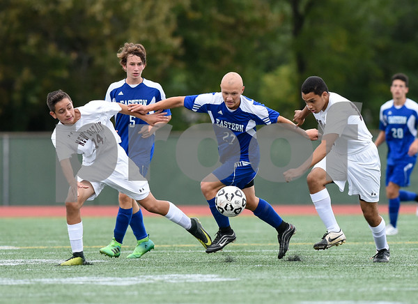 09/19/17 Wesley Bunnell | Staff Bristol Eastern boys soccer defeated New Britain 7-0 on Tuesday afternoon at Veteran's Stadium in New Britain. Bristol Easterns Lyle Winiarski #27, center, battles two New Britain played including Minel Mehmedovic (14) and Kevin Carrasavillo (12).