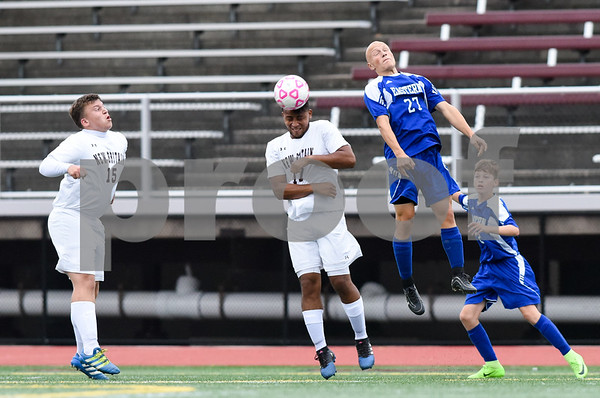09/19/17 Wesley Bunnell | Staff Bristol Eastern boys soccer defeated New Britain 7-0 on Tuesday afternoon at Veteran's Stadium in New Britain. New Britain's Eldin Duric (15), Nolber Gonzalez (17) and Bristol Easterns Lyle Winiarski #27.