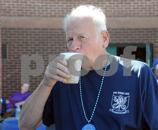 9/23/2017 Mike Orazzi | Staff Franz Koch sips a beer during the St. Peter Church Oktoberfest in New Britain Saturday.