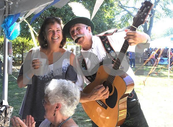 9/23/2017 Mike Orazzi | Staff Schachtelgebirger Musikanten's Ron Kwas with Kim Dzioba during the St. Peter Church Oktoberfest in New Britain Saturday.
