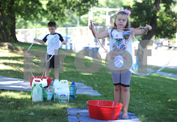 9/23/2017 Mike Orazzi   Staff Nathan and Emma Johnson make giant bubbles in the Kids Zone during the 56th Annual Chrysanthemum Festival on Saturday in Bristol