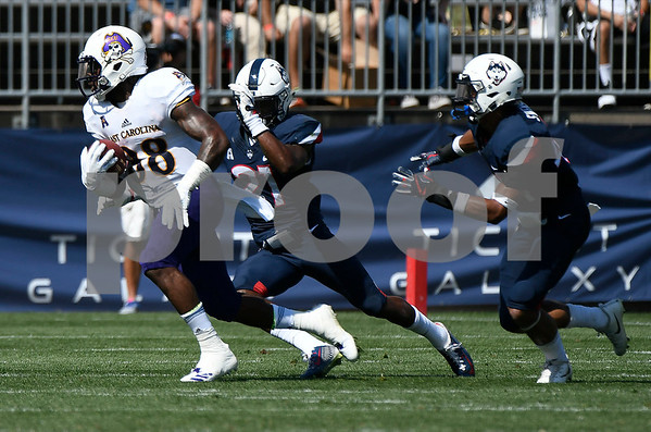 9/24/2017 Mike Orazzi | Staff UConn's Jamar Summers (21) and East Carolina State University's Trevon Brown (88) at Rentschler Field in East Hartford.