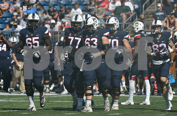 9/24/2017 Mike Orazzi | Staff The UConn line during Sunday's football game with East Carolina State University at Rentschler Field in East Hartford.