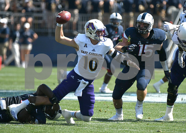 9/24/2017 Mike Orazzi | Staff UConn's Junior Joseph (11) and East Carolina State University's Thomas Sirk (10) at Rentschler Field in East Hartford Sunday.
