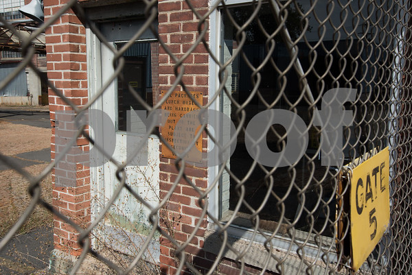 09/26/17 Wesley Bunnell | Staff Old signs on a guard shack on the rear of a Stanley Black & Decker building on Curtis St near the intersection with Myrtle St which is marked for demolition.