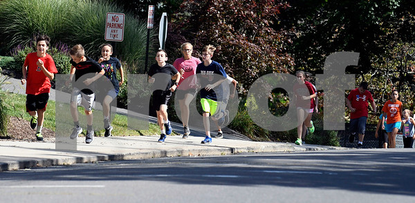 9/7/2017 Mike Orazzi | Staff Members of the St. Joseph School Cross Country Team while practicing while running North on Queen Street Thursday afternoon.