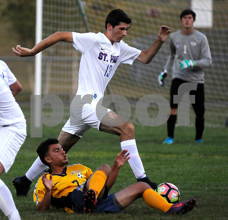 9/8/2017 Mike Orazzi | Staff St. Paul Boys Soccer's Justin Rigsby (13) and Kennedy's Donaldi Sino (7) Friday in Bristol.