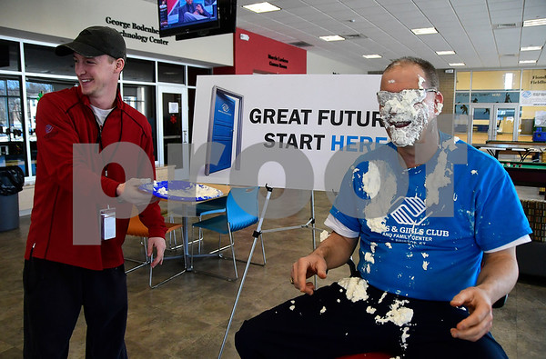 3/23/2017 Mike Orazzi | Staff Tyler Knopp after pushing a plate of whipped cream Ron Burns' face as part of the Final Four of the Brackets for Good Competition. Ron Burns has been working for the Boys & Girls Club of Bristol Family Center for over 37 years and was willing to take whipped cream for a $20 donation Thursday afternoon.