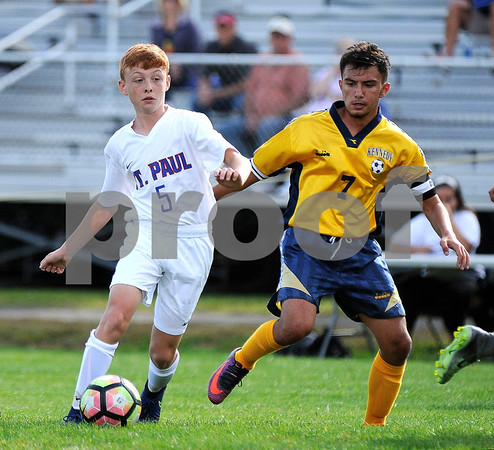 9/8/2017 Mike Orazzi | Staff St. Paul Boys Soccer's Danny Bond (5) Kennedy's Donaldi Sino (7) Friday in Bristol.