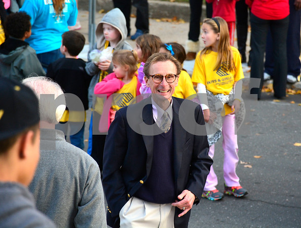 11/11/2014 Mike Orazzi | Staff Bristol Boys & Girls Club CPO Michael Suchopar as kids as they parade from the 100 year old Boys & Girls Club Building at 105 Laurel St., across to Meadow Street and on to the new facility at 255 West St. for their fist look at the new club.